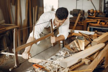 handsome-carpenter-working-with-wood_1157-26098